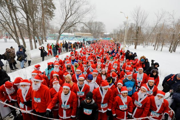 People dressed as Father Frost, the Russian equivalent of Santa Claus, participate in the race 'HappyRun'...