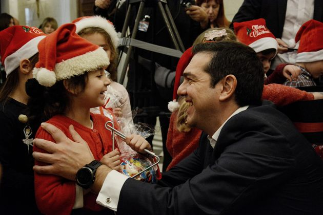 Children sing Christmas carols to Greek Prime Minister Alexis Tsipras in Maximos