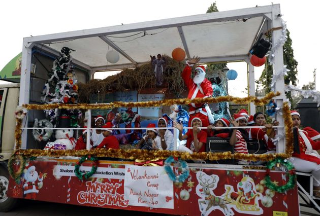 People paritcipate in the 'Best Santa Claus' competition, organised by the Christmas Shalom Christian...