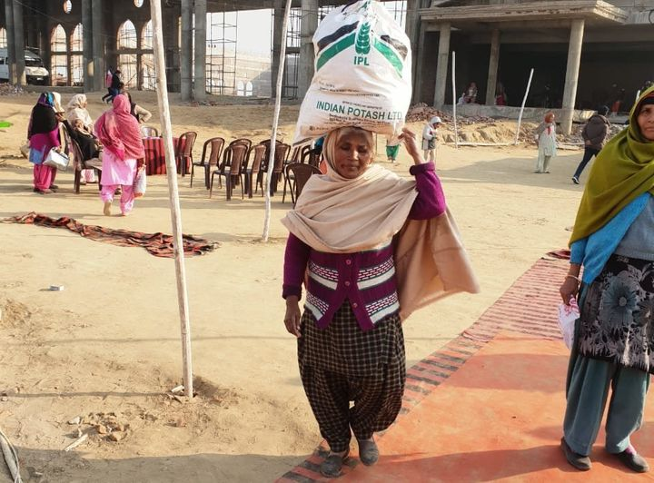 On the Christmas eve, 68-years-old Kartari Devi collecting ration from a private church in Jalandhar district of Punjab.