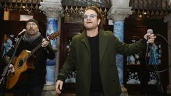 Bono And U2's The Edge Busk For Dublin's Homeless In Festive