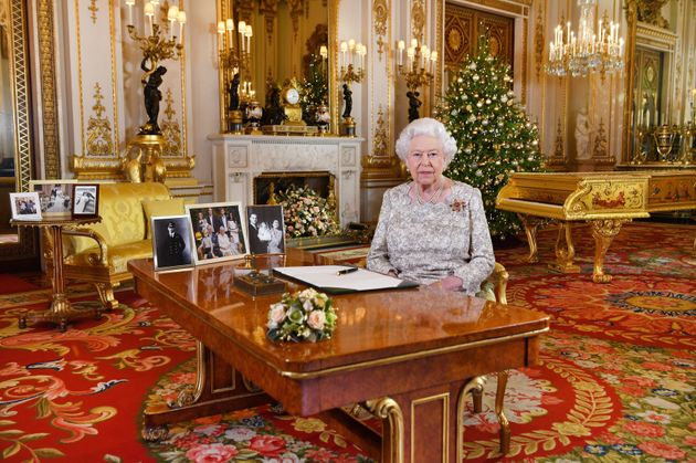 The Queen's Speech was recorded in Buckingham Palace's White Drawing Room, surrounded by family