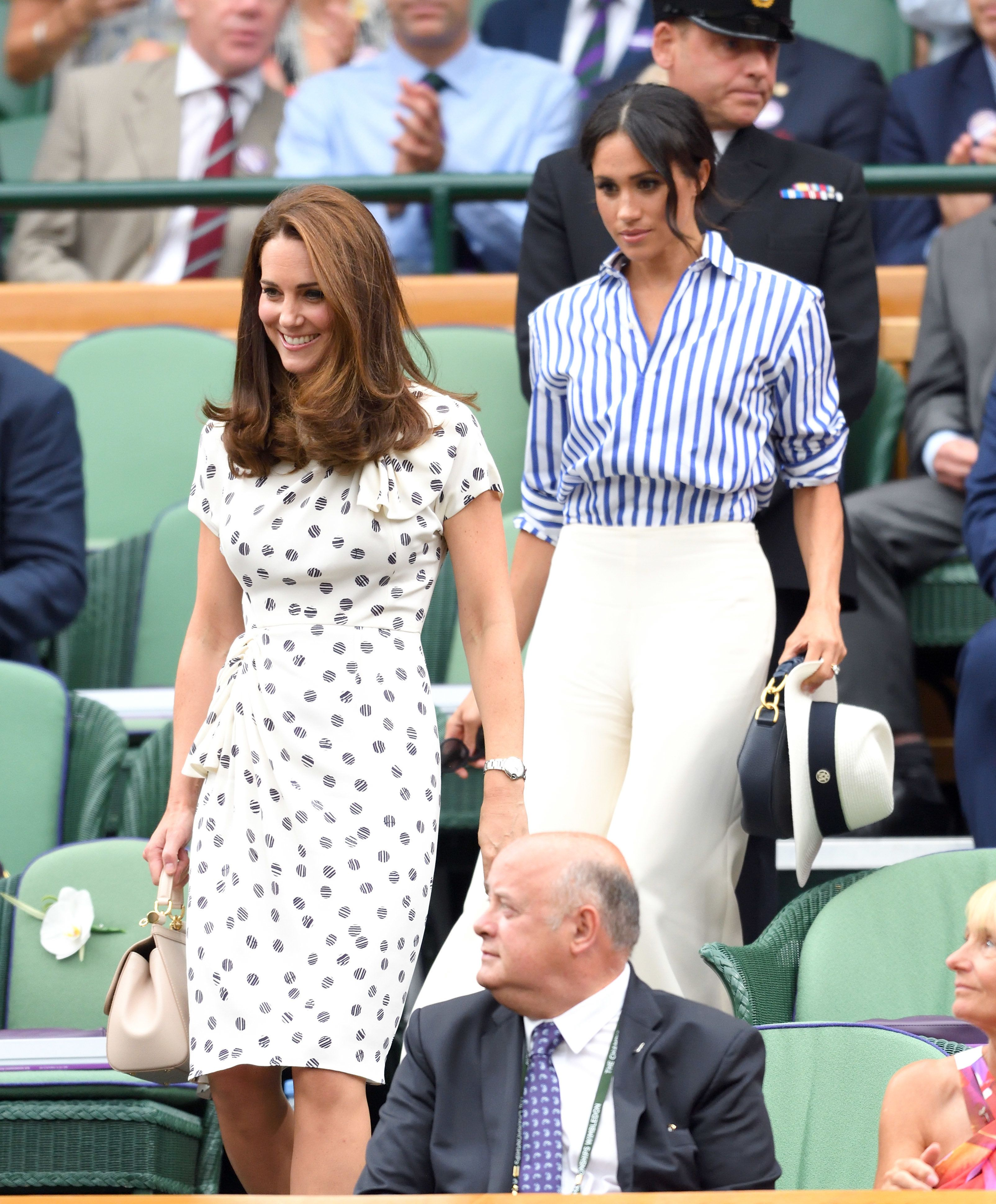 LONDON, ENGLAND - JULY 14:  Catherine, Duchess of Cambridge and Meghan, Duchess of Sussex attend day twelve of the Wimbledon Tennis Championships at the All England Lawn Tennis and Croquet Club on July 14, 2018 in London, England.  (Photo by Karwai Tang/WireImage )