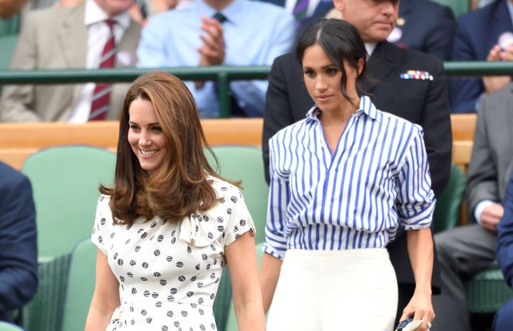 Catherine, Duchess of Cambridge, and Meghan, Duchess of Sussex, attend the Wimbledon Tennis Championships on July 14 in Londo