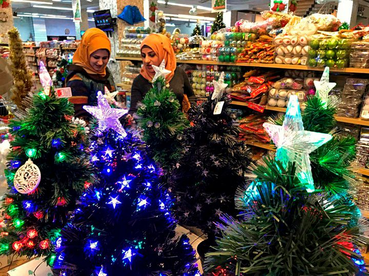 Two women in Iraq shop on Christmas Eve.