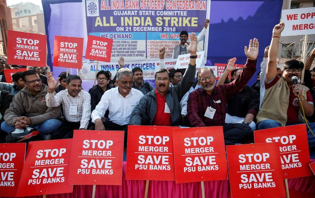State-run bank employees shout slogans and carry placards during a day-long nationwide strike, in Ahmedabad,...