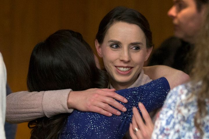 Rachael Denhollander hugs Larissa Boyce at the conclusion of Larry Nassar's sentencing.