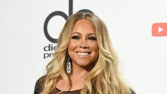 Mariah Carey poses in the press room at the American Music Awards on Tuesday, Oct. 9, 2018, at the Microsoft Theater in Los Angeles. (Photo by Jordan Strauss/Invision/AP)