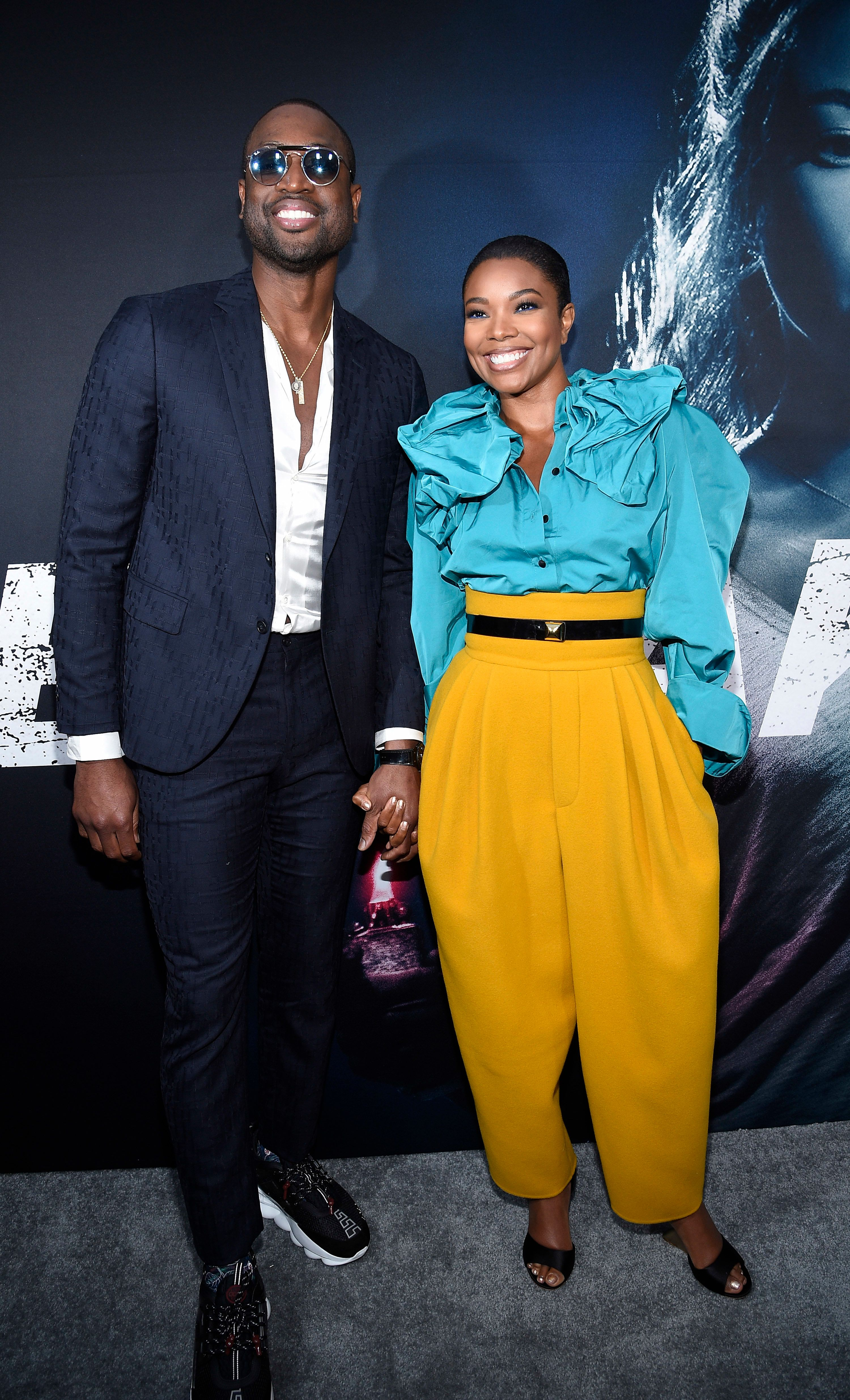 HOLLYWOOD, CA - MAY 01: Cast member Gabrielle Union and her husband basketball player for the Miami Heat Dwyane Wade arrive for Universal Pictures' special screening of the film 'Breaking In' at ArcLight Cinemas on May 1, 2018 in Hollywood, California. (Photo by Kevork Djansezian/Getty Images)