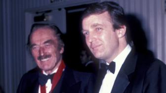 A new report suggests that Donald Trump's diagnosis of bone spurs may have been made at the request of his father, Fred Trump (pictured with his son in 1985).