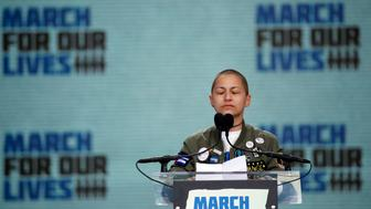 """Emma Gonzalez, a survivor of the mass shooting at Marjory Stoneman Douglas High School in Parkland, Fla., closes her eyes and cries as she stands silently at the podium for the amount of time it took the Parkland shooter to go on his killing spree during the """"March for Our Lives"""" rally in support of gun control in Washington, Saturday, March 24, 2018. (AP Photo/Alex Brandon)"""