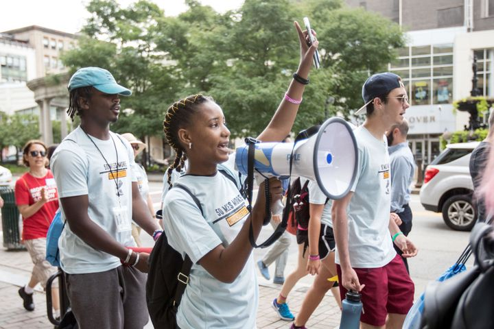 Participants in the 50 Miles More walk against gun violence head for Smith & Wesson's headquarters in Springfield,