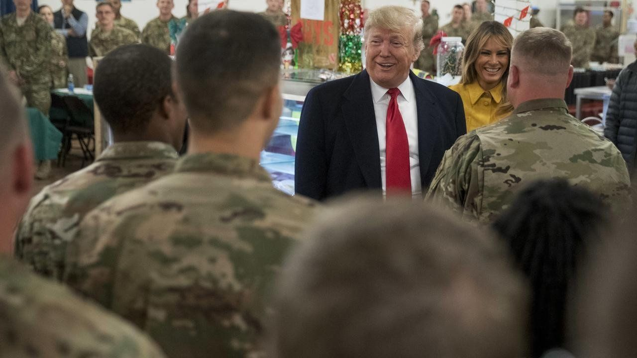 President Donald Trump and first lady Melania have visited US troops at Al Asad Air Base in Iraq