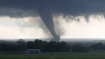 "This image made from a video taken through a car window shows a tornado near Wynnewood, Okla., Monday, May 9, 2016. A broad tornado capable of leaving ""catastrophic"" damage in its wake churned across the Oklahoma landscape Monday, prompting forecasters to declare a tornado emergency for two communities directly in its path. (Hayden Mahan via AP) MANDATORY CREDIT"