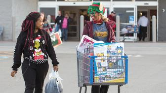 Jzonte Leonard, left, and Fannia Woodfolk do some last minute shopping on Christmas Eve at Walmart on Hinkleville Road in Paducah, Ky. Walmart shut it's doors at 6:00 P.M. on Christmas Eve and will remain closed until Dec. 26, 2018. (Ellen O'Nan/The Paducah Sun via AP)