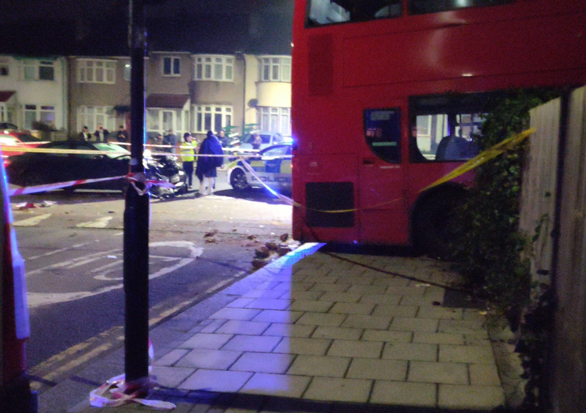 Double-decker bus ploughs into garden in south London