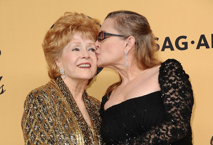 Debbie Reynolds and Carrie Fisher pose in the press room at the 21st annual Screen Actors Guild Awards on Jan. 25, 2015 in Lo