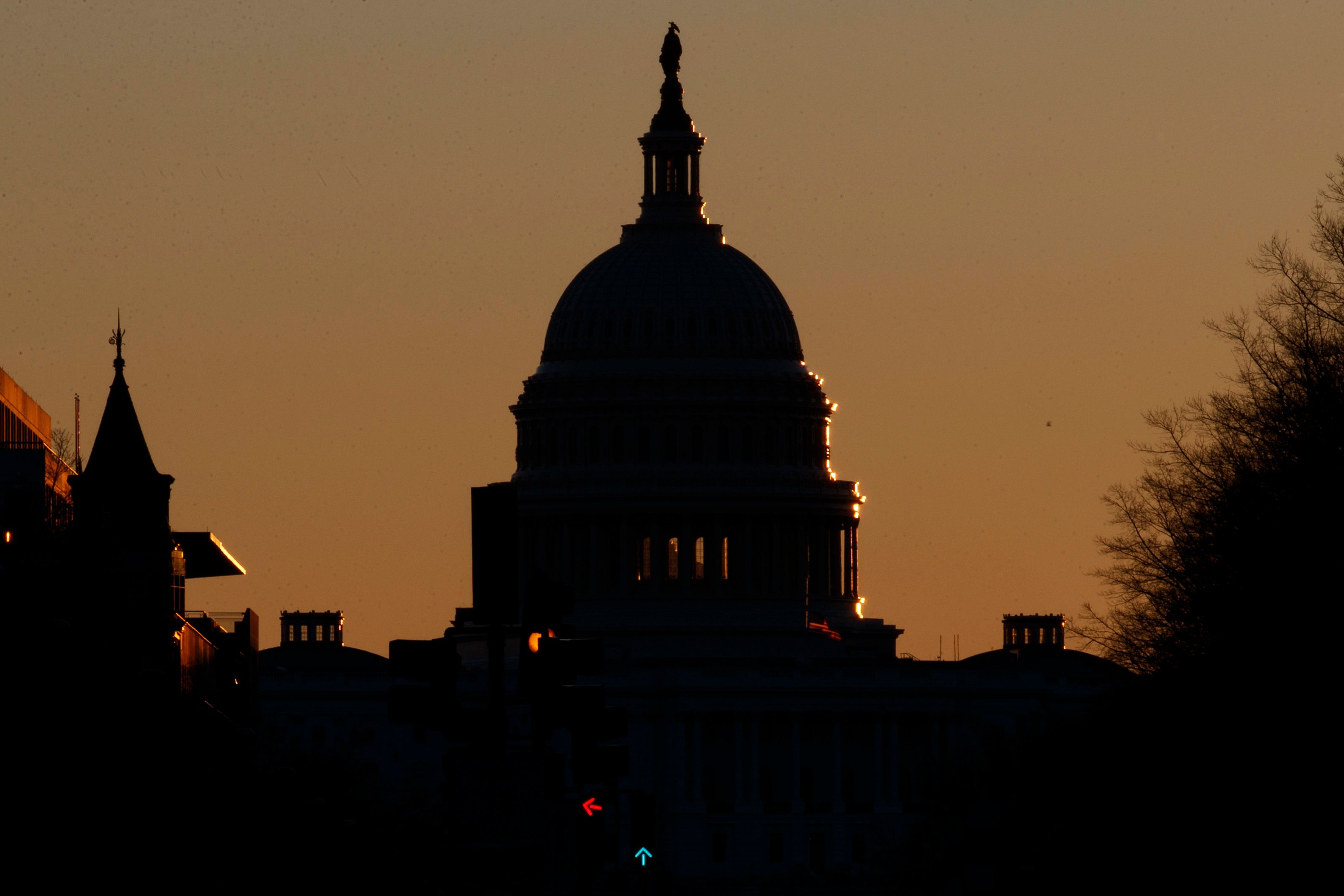 The U.S. Capitol Dome is seen in silhouette as the sun rises in Washington, Sunday, Dec. 23, 2018. The federal government is expected to remain partially closed past Christmas Day in a protracted standoff over President Donald Trump's demand for money to build a border wall with Mexico. (AP Photo/Carolyn Kaster)