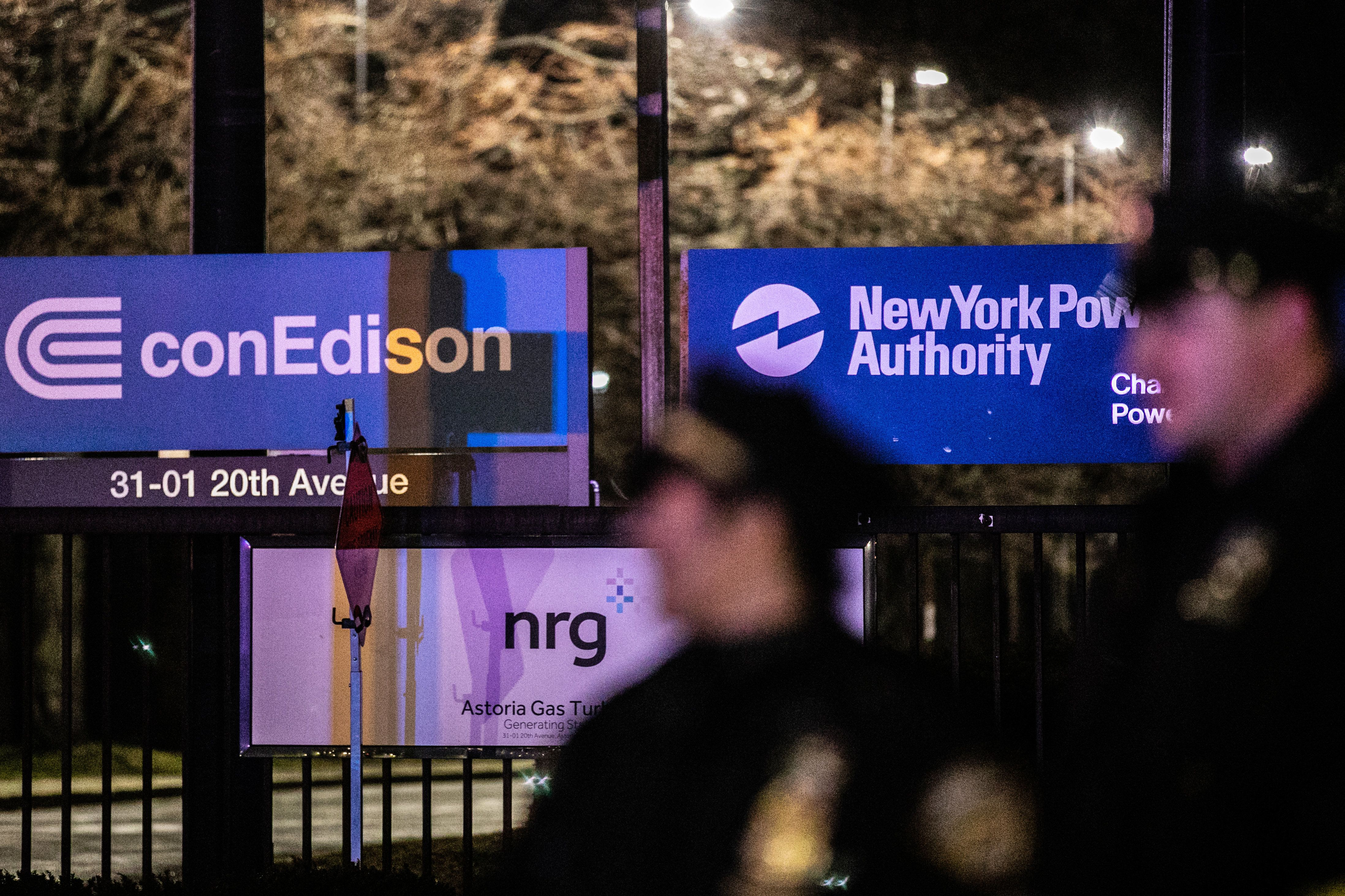 New York Police Department officers stand outside a Consolidated Edison plant in Astoria on Thursday night.