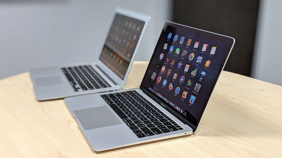 The old MacBook Air (rear) and this year's model