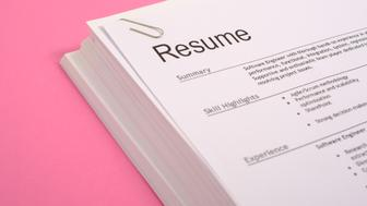 Pile of cv on pink background as equal opportunities concept