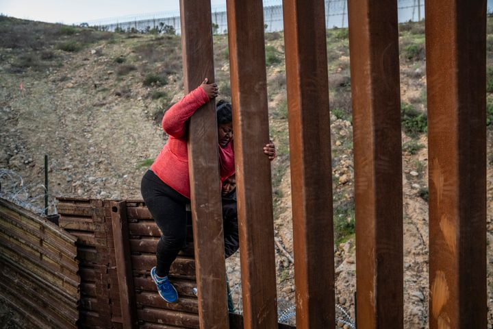 A migrant climbs the border fence before jumping into the U.S. to San Diego, Calif., from Tijuana, Mexico, on Dec. 27, 2018.&