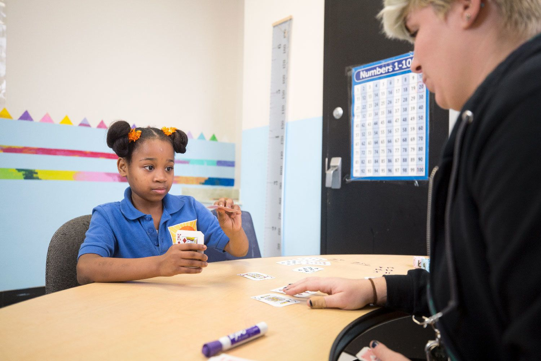 Misty Johnson does a warm-up activity with Jordan Coughlin, a math teacher at the Center for