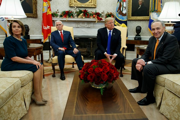 Nancy Pelosi (D-Calif.), Vice President Mike Pence, President Donald Trump and Chuck Schumer (D-N.Y.) wait as media leave a meeting in the Oval Office on Dec. 11.