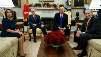 House Minority Leader Rep. Nancy Pelosi, D-Calif., Vice President Mike Pence, President Donald Trump, and Senate Minority Leader Chuck Schumer, D-N.Y., wait as media leave a meeting in the Oval Office of the White House, Tuesday, Dec. 11, 2018, in Washington. (AP Photo/Evan Vucci)