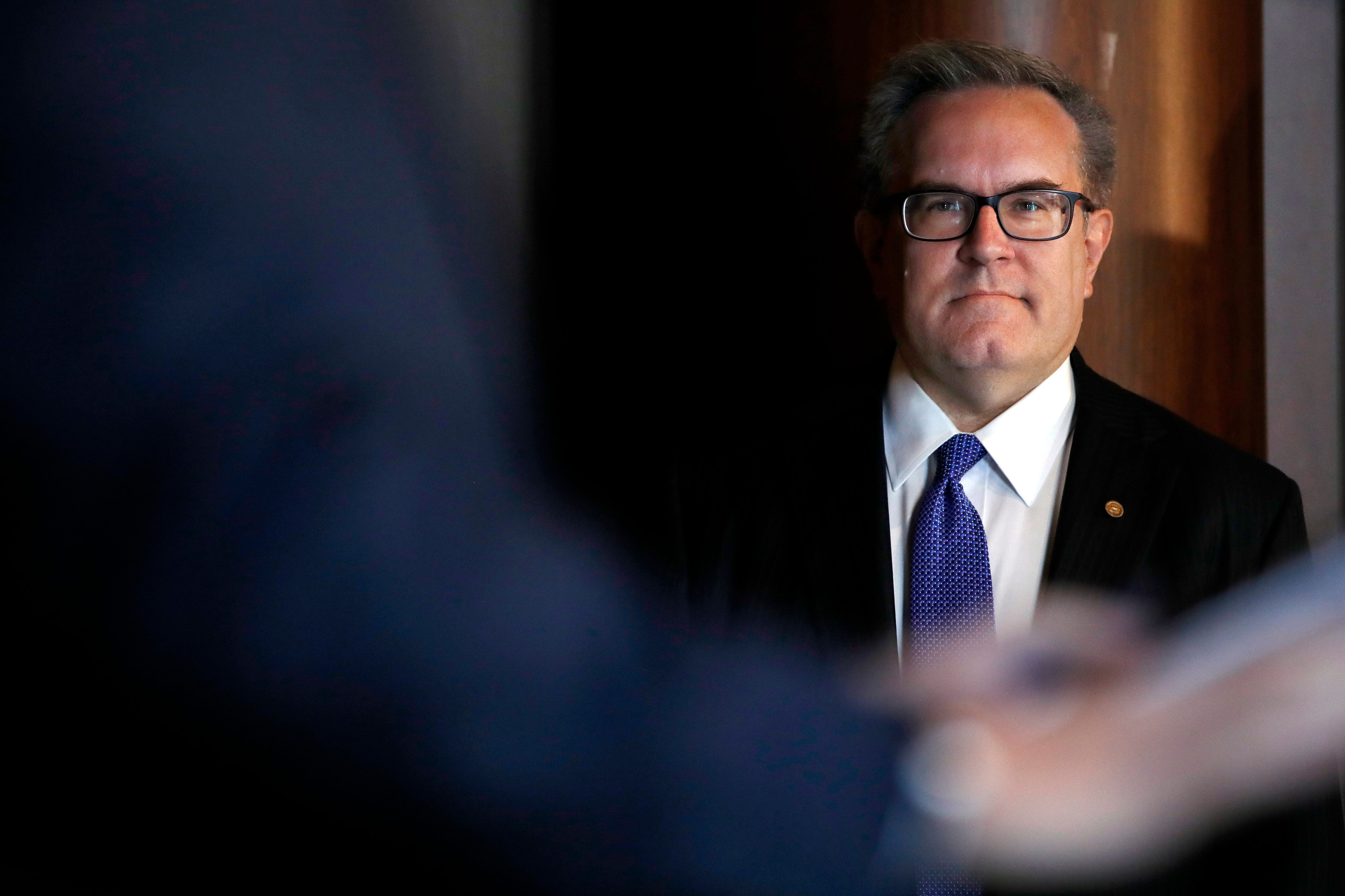 Environmental Protection Agency (EPA) Acting Administrator Andrew Wheeler listens as he is introduced to speak to EPA staff, Wednesday, July 11, 2018, at EPA Headquarters in Washington. (AP Photo/Jacquelyn Martin)