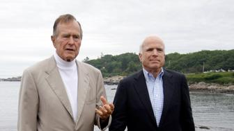 Republican presidential candidate Sen. John McCain, R-Ariz., right, and former President George H.W. Bush hold a news conference at the Bush family home in Kennebunkport, Maine, Monday, July 21, 2008. (AP Photo/Carolyn Kaster)