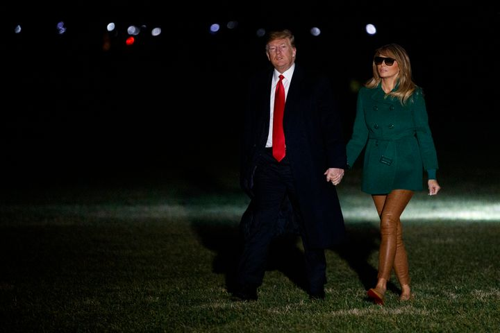 Donald and Melania Trump arrive on the South Lawn of the White House on Thursday after making a surprise visit to troops in I