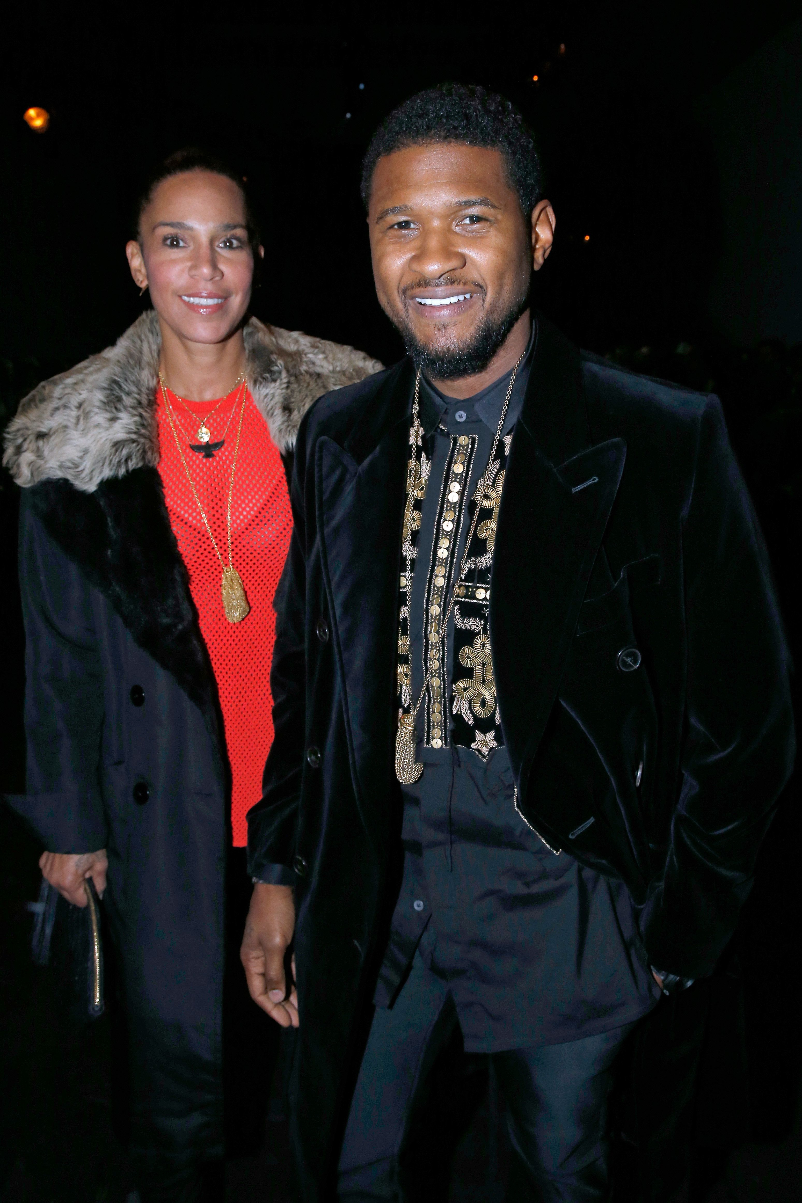 PARIS, FRANCE - JANUARY 20:  Singer Usher and his wife Grace Miguel attend the Berluti Menswear Fall/Winter 2017-2018 show as part of Paris Fashion Week on January 20, 2017 in Paris, France.  (Photo by Bertrand Rindoff Petroff/Getty Images)