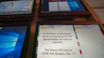 A monitor in the House of Representatives displays a schedule update on Capitol Hill in Washington, Friday, Dec. 28, 2018, The partial government shutdown will almost certainly be handed off to a divided government to solve in the new year, as both parties traded blame Friday and President Donald Trump sought to raise the stakes in the weeklong impasse. (AP Photo/J. Scott Applewhite)