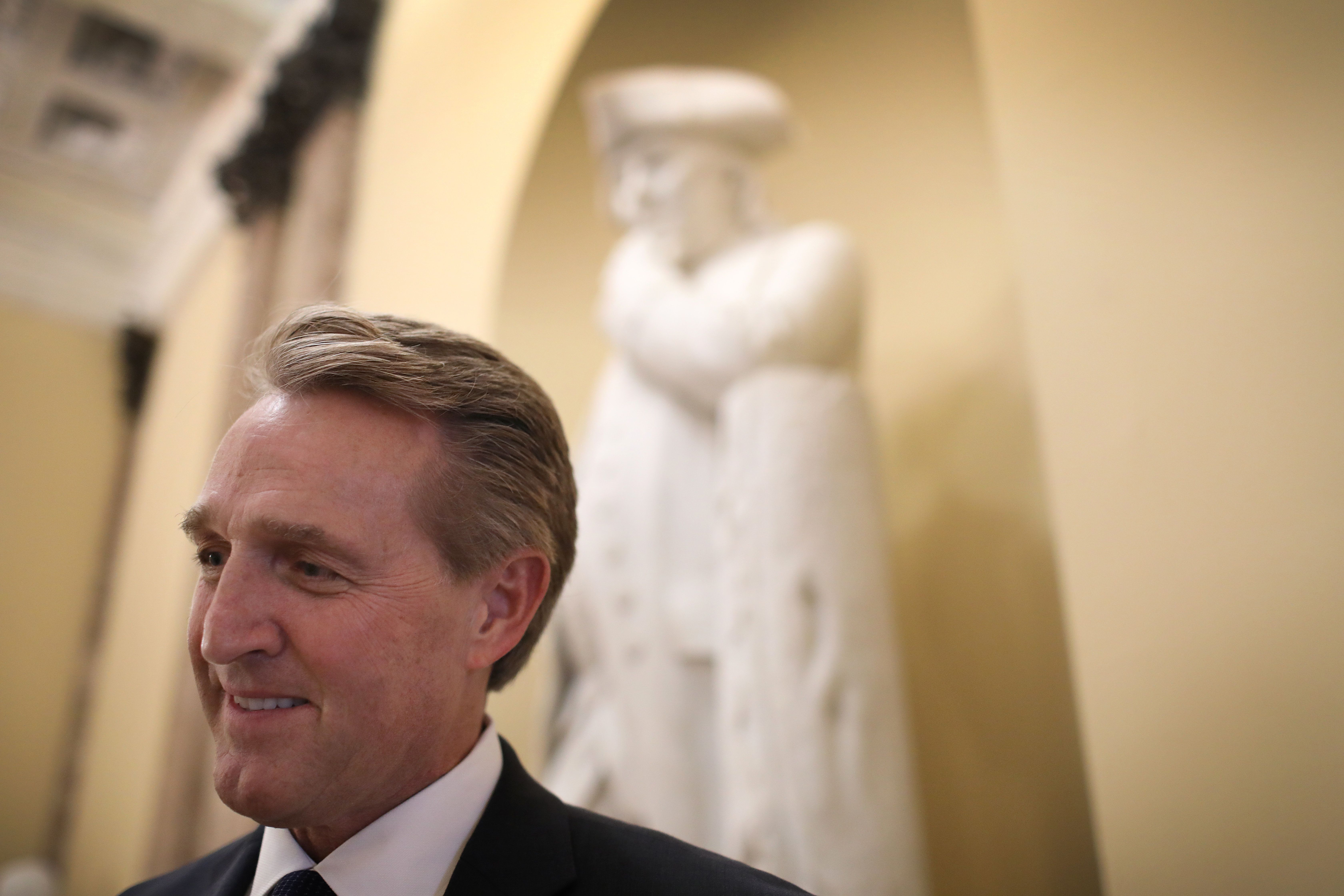 "WASHINGTON, DC - DECEMBER 13: Sen. Jeff Flake (R-AZ) answers questions from a reporter after delivering his farewell speech on the floor of the U.S. Senate December 13, 2018 in Washington, DC. During his speech Flake said, ""Let us recognize from this place here today that the shadow of tyranny is once again enveloping parts of the globe. And let us recognize as authoritarianism reasserts itself in country after country, that we are by no means immune.' (Photo by Win McNamee/Getty Images)"