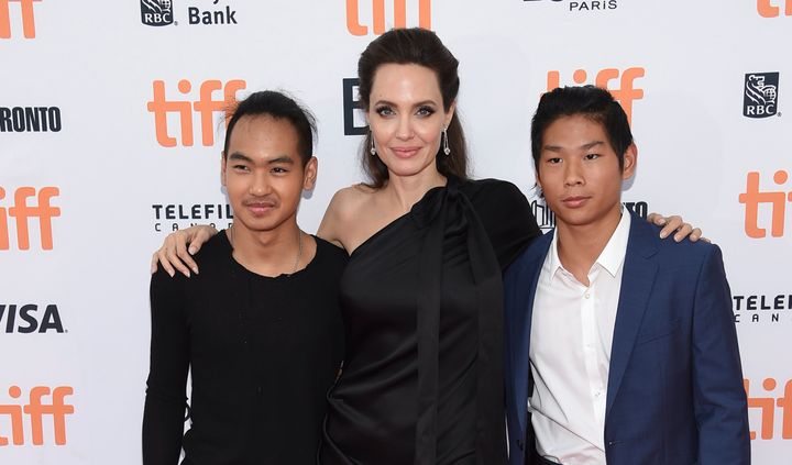 "Maddox Jolie-Pitt, Angelina Jolie and Pax Jolie-Pitt attend a premiere for ""First They Killed My Father"" at the Toronto Inter"