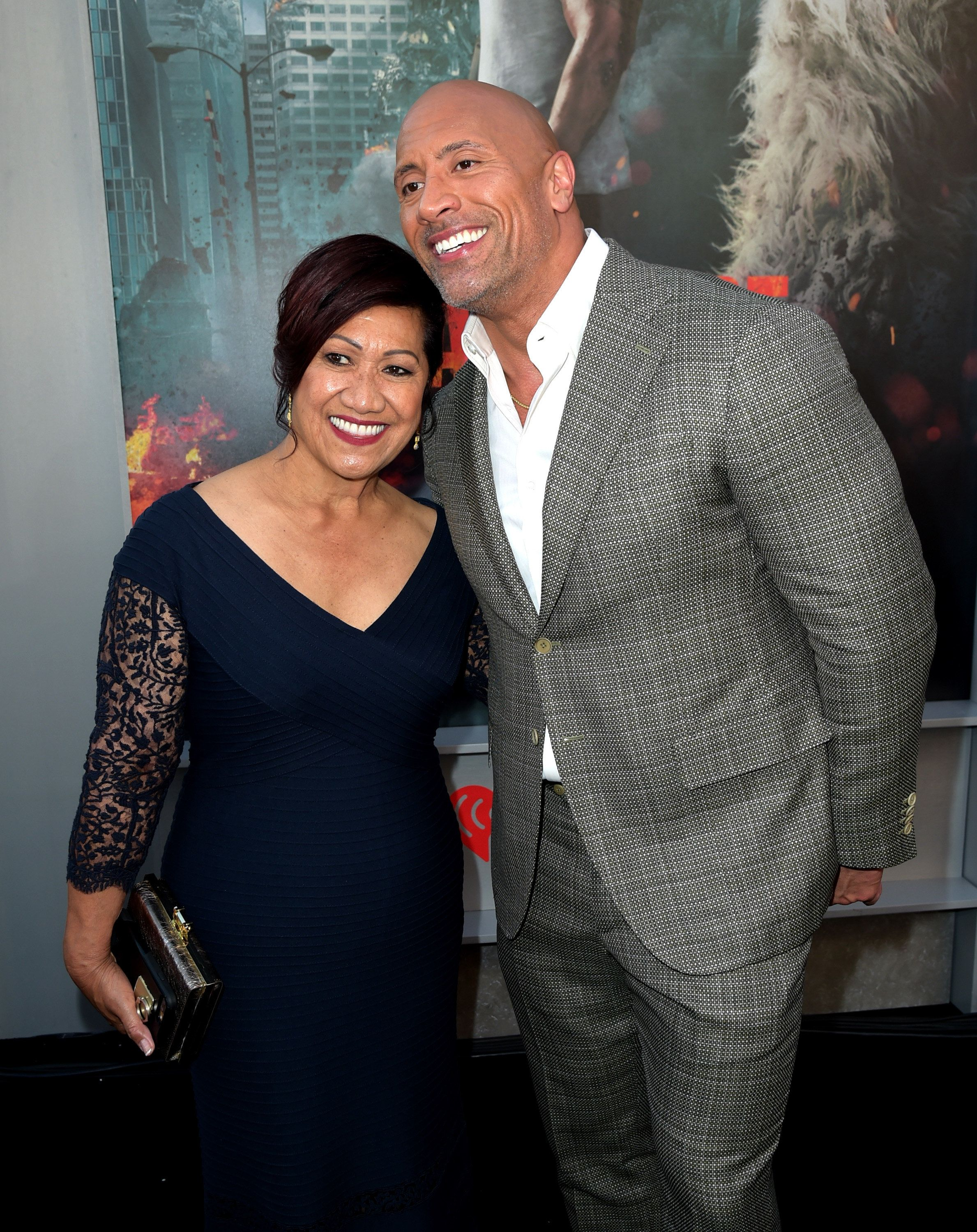 LOS ANGELES, CA - APRIL 04:  Actor Dwayne Johnson (R) and his mother Ata Johnson arrive at the premiere of Warner Bros. Pictures' 'Rampage' at the Microsoft Theatre on April 4, 2018 in Los Angeles, California.  (Photo by Kevin Winter/Getty Images)