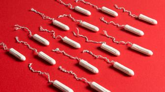 Rows of tampons on a red background