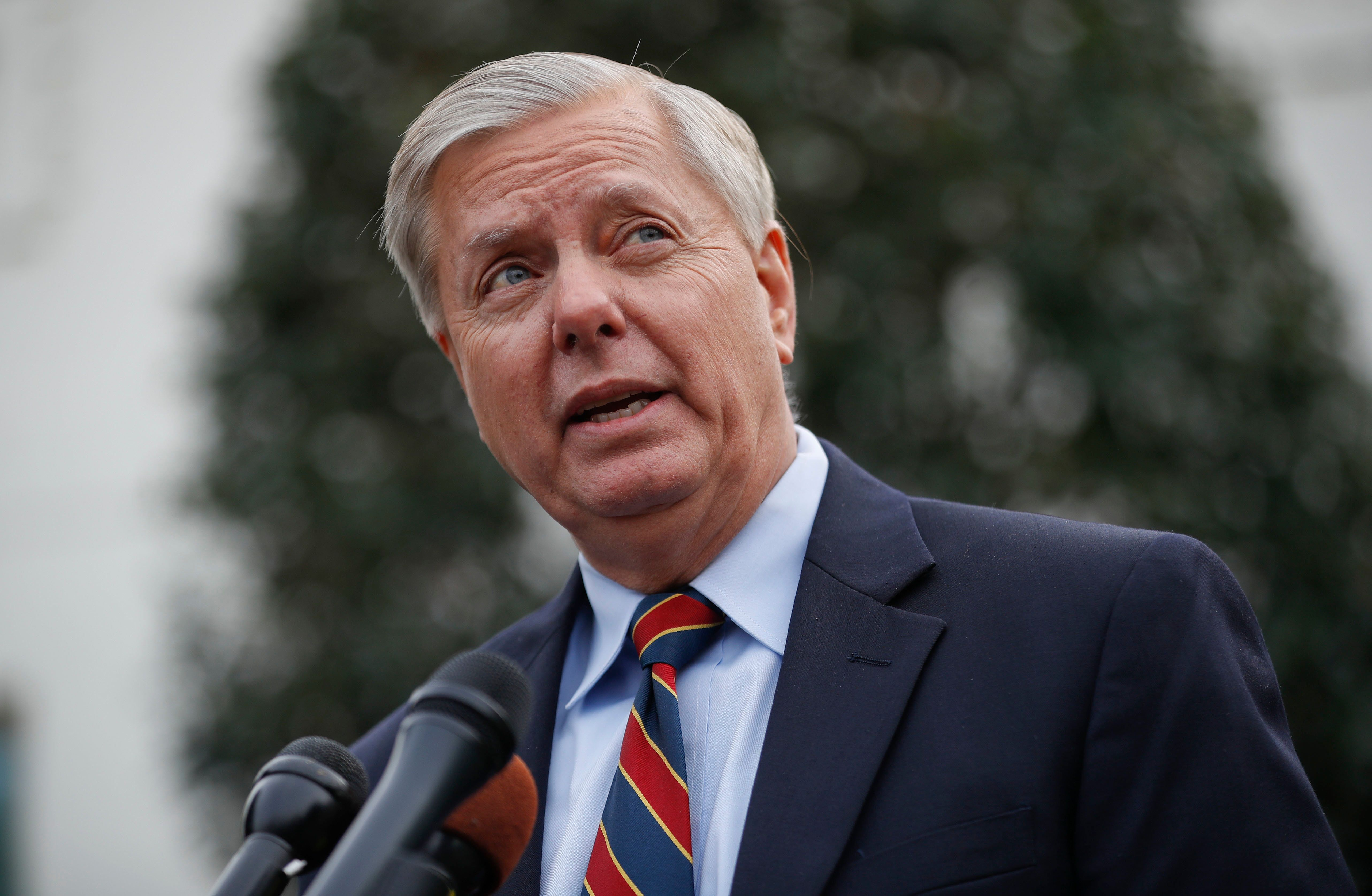 Sen. Lindsey Graham, R-S.C., speaks to members of the media outside the West Wing of the White House in Washington, after his meeting with President Donald Trump, Sunday, Dec. 30, 2018. (AP Photo/Pablo Martinez Monsivais)