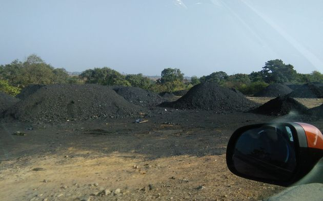 Coal mounds seen on the way to the site of disaster. The mine at Ksan, according to the families...