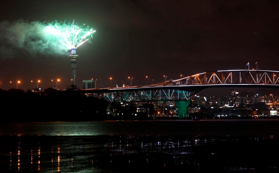 Pyrotechnics erupt from Auckland's Sky Tower as thousands of revellers welcome