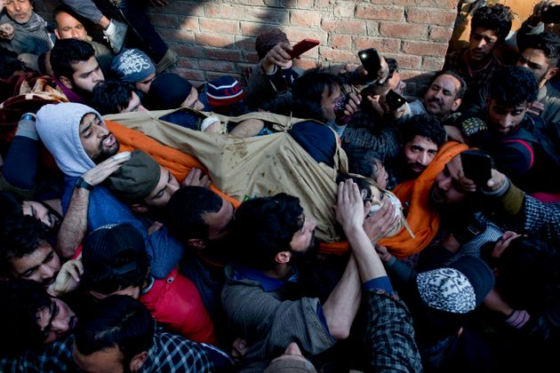 In Kashmir, where civilians jostle to touch their hands to the feet of dead militants at funerals, and...