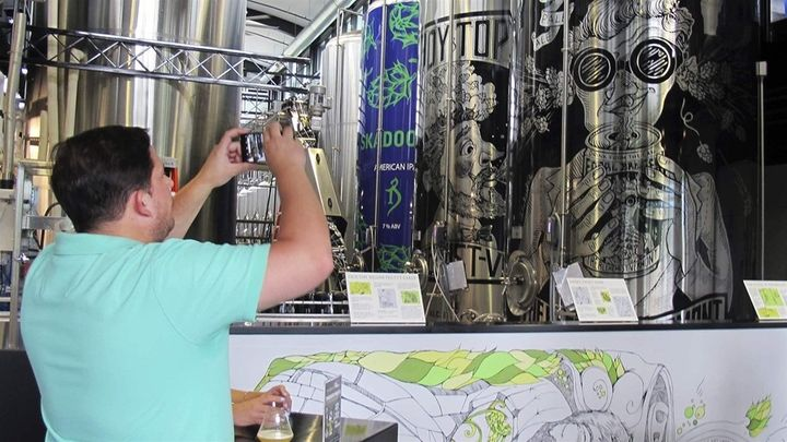 A tourist from New York City visits the Alchemist brewery in Stowe, Vermont. Vermont is trying to tempt tourists into becomin