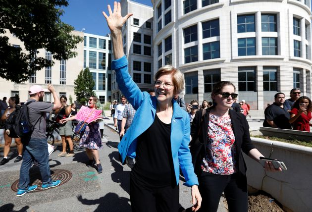 Elizabeth Warren waves as activists gather for a protest march and rally in opposition to US Supreme...