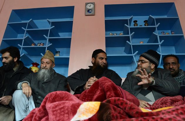 Masrat Alam (centre) speaks to visitors at his house in Srinagar on 12 March