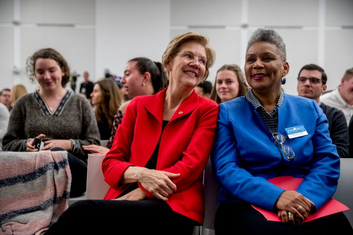 Sen. Elizabeth Warren (D-Mass.) speaks with American University senior associate dean Brenda Smith, right, after speaking at