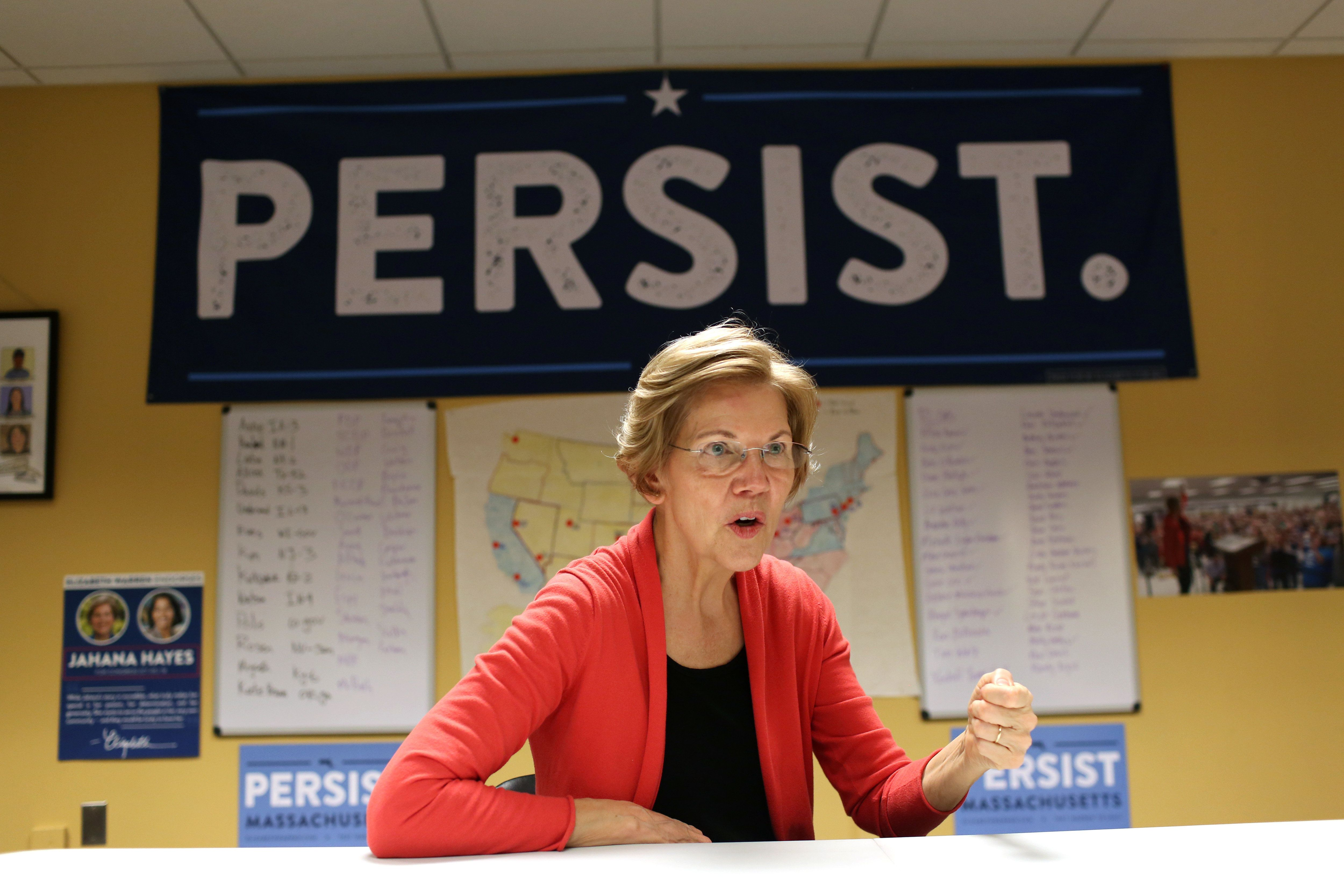 BOSTON, UNITED STATES - OCTOBER 12:  Senator Elizabeth Warren speaks in the Democratic Outreach Team's room at her campaign headquarters in Dorchester. A map of competitive congress races that the team is tracking is hung up on the wall behind her. (Photo by Hadley Green for The Washington Post via Getty Images)