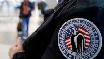 A TSA worker works at O'Hare International Airport in Chicago, Tuesday, Dec. 25, 2018. The National Treasury Employees Union says some federal government employees already are feeling the effects of the partial government shutdown. Of the roughly 800,000 federal employees facing deferred pay, more than half were deemed essential, such as U.S. Secret Service agents and Transportation Security Administration airport agent. About 380,000 were to be furloughed. Legislation ensuring that workers receive back pay was expected to clear Congress. (AP Photo/Nam Y. Huh)