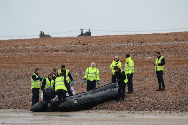 The UK's Border Force carries an intercepted migrant dinghy off the Kent