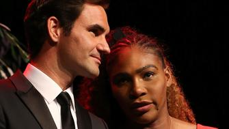 PERTH, AUSTRALIA - DECEMBER 31: Roger Federer of Switzerland and Serena Williams of the United States share a moment on stage at the Hopman Cup New Years Eve Gala dinner during day three of the 2019 Hopman Cup at RAC Arena on December 31, 2018 in Perth, Australia. (Photo by Paul Kane/Getty Images)